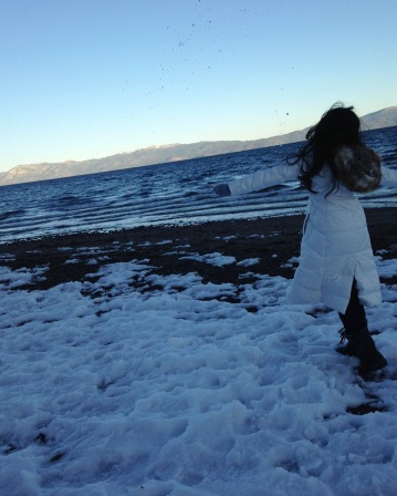 Your author in the snow by a lake